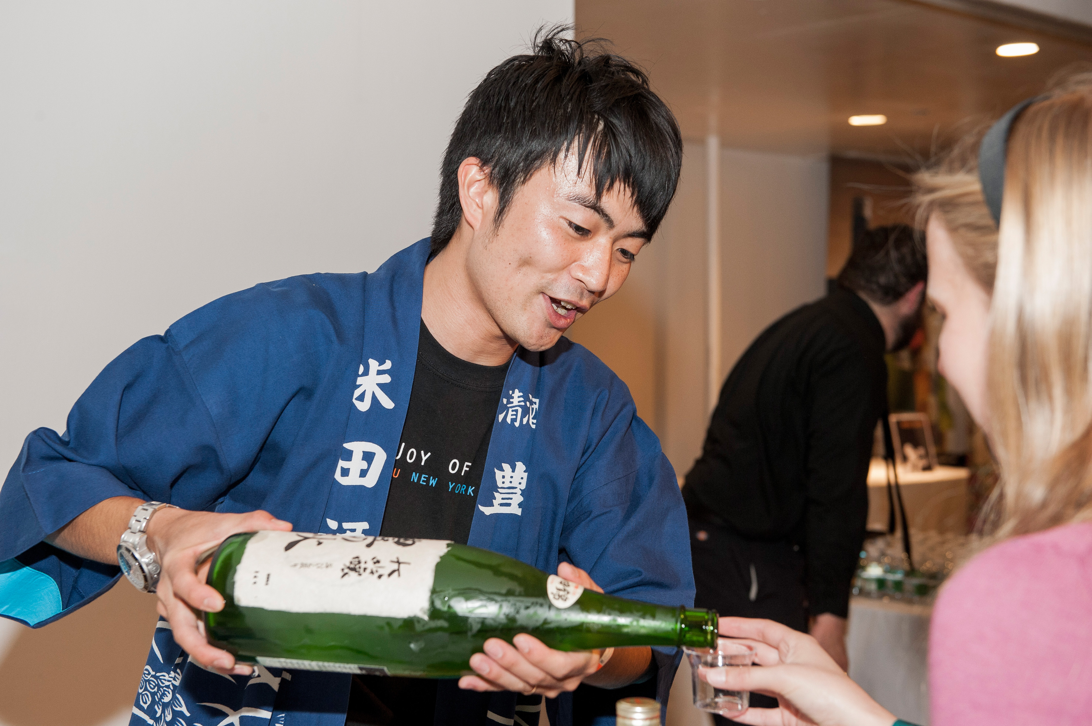 The Joy of Sake pouring